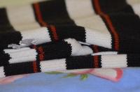 Шерстяной свитер сложенный в стопку